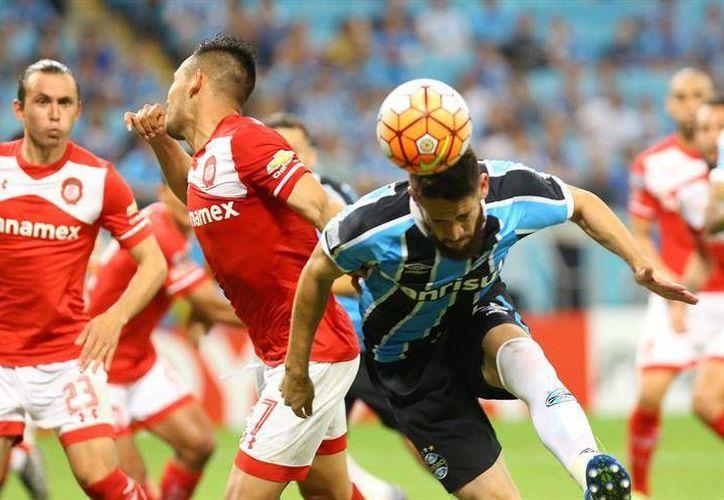 Con el 1-0 Gremio ratificó el segundo puesto del grupo 6 de la Libertadores y puso fin al invicto del Toluca. (EFE)