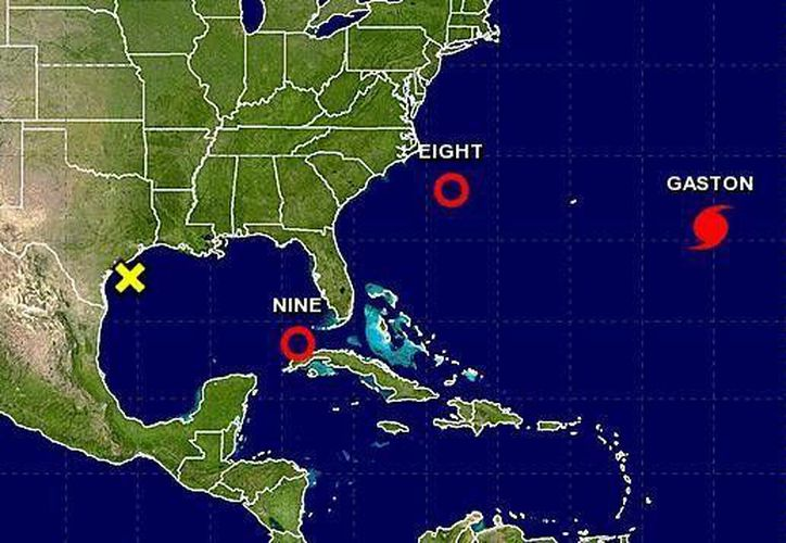 La Depresión Tropical Nueve, en el Océano Atlántico, se localizó  365 kilómetros noreste de Cancún. (NOAA)
