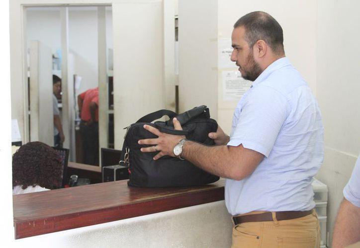 A su ingreso, el litigante, no hizo ninguna declaración del por qué no se presentó Eduardo Espinosa. (Joel Zamora/SIPSE)