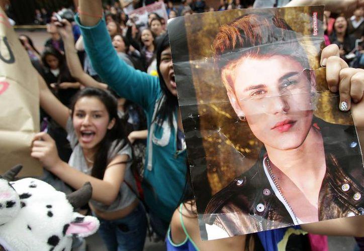 "Como parte de su gira ""Believe Tour"", Justin Bieber le dio al grafiti en Bogotá. (EFE/Archivo)"