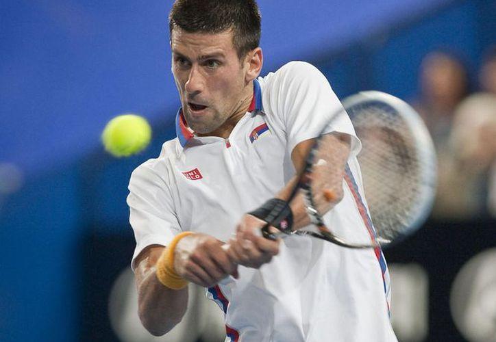 Djokovic abandonó inmediatamente la cancha para recibir atención médica. (Foto: EFE)