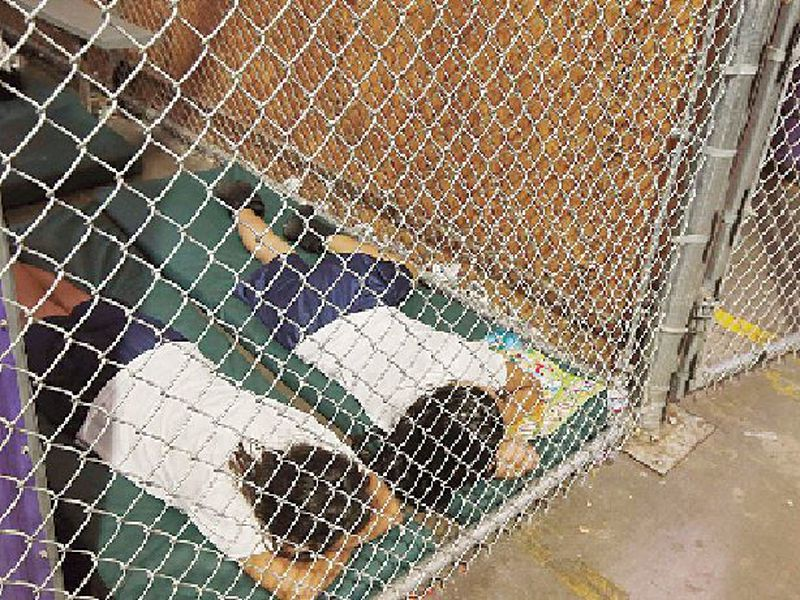 In this June 18, 2014 file photo, two female detainees sleep in a holding cell,at the U.S. Customs and Border Protection Nogales Placement Center in Nogales, Ariz.