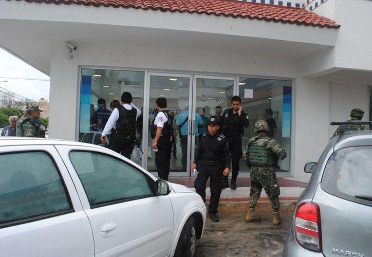 La Policía Judicial ya analiza el video del día del robo,que fue proporcionado por el banco. (Eric Galindo/SIPSE)