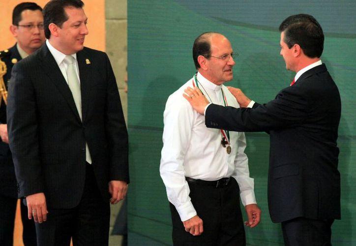 México no va a cambiar mientras las mujeres no sean escuchadas, dijo Solalinde a Peña Nieto. (Reforma)