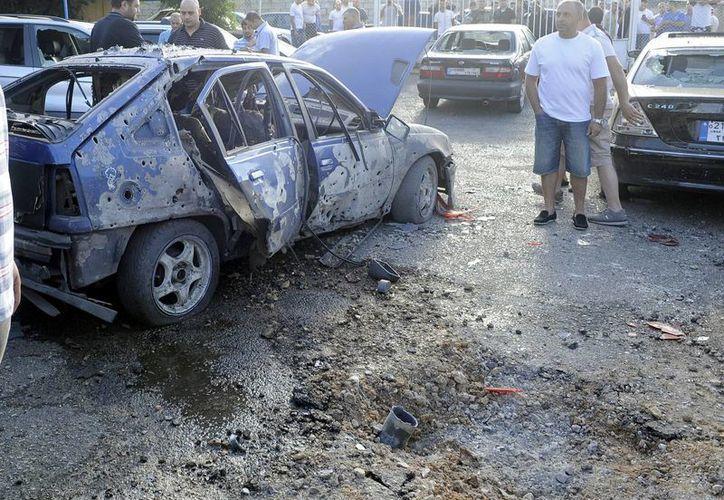 Al menos cuatro personas resultaron heridas hoy por la mañana con el impacto de dos proyectiles en uno de los bastiones del grupo chií libanés Hizbulá. (EFE)