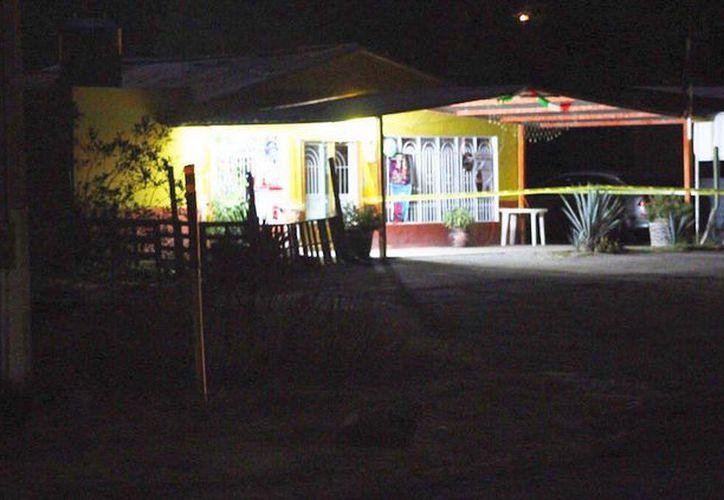 Un hombre, su esposa e hijo de un año fueron asesinados en Barrio Nuevo, entrando a su casa. (Foto: Sin Embargo)