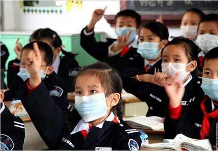 Un niño con gripa puede contagiar de cinco a ocho más que conviven con él. (Contexto/Internet)