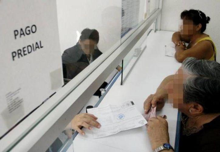 El pago promedio del impuesto predial en Mérida es de 700 pesos. El Catastro Municipal detectó construcciones no reportadas en unos 80 mil predios. (SIPSE/Foto de archivo)