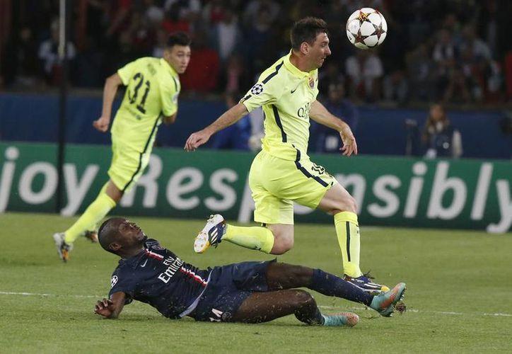 Aunque Neymar y Lionel Messi (foto) se coordinan cada vez mejor, el Barcelona no pudo con el Paris Saint-Germain. (AP)