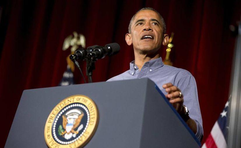 El presidente de los Estados Unidos, Barack Obama, anunció un decreto a favor del sector trabajador durante un desayuno con varios sindicatos en Boston. Allí acusó a los republicanos de frenar la economía estadounidense. (AP)