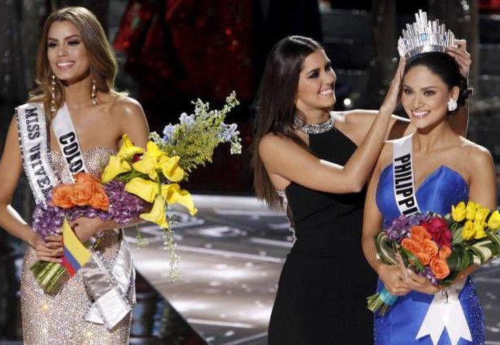 La filipina Pia Alonzo Wurtzbach,fue elegida anoche nueva reina de belleza en la edición 64 de Miss Universo, tras una confusión que en primera instancia había otorgado la corona a la colombiana Ariadna Gutiérrez. (Notimex)