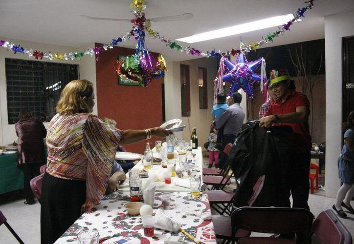 A pesar de las dificultades económicas, los yucatecos trataron de apegarse este año a las tradiciones de Año Nuevo. (Theani Ruz/SIPSE)