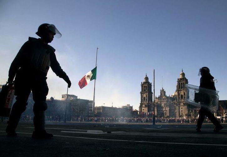 La policía capitalina informó que las actividades por la conmemoración de la matanza del 2 de octubre del 68 se realizaron con tranquilidad. (AP)