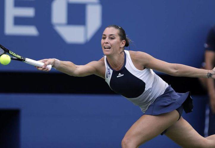 Flavia Pennetta ganó en dos sets a Roberta Vinci la final italiana femenil del Abierto de EU. (AP)