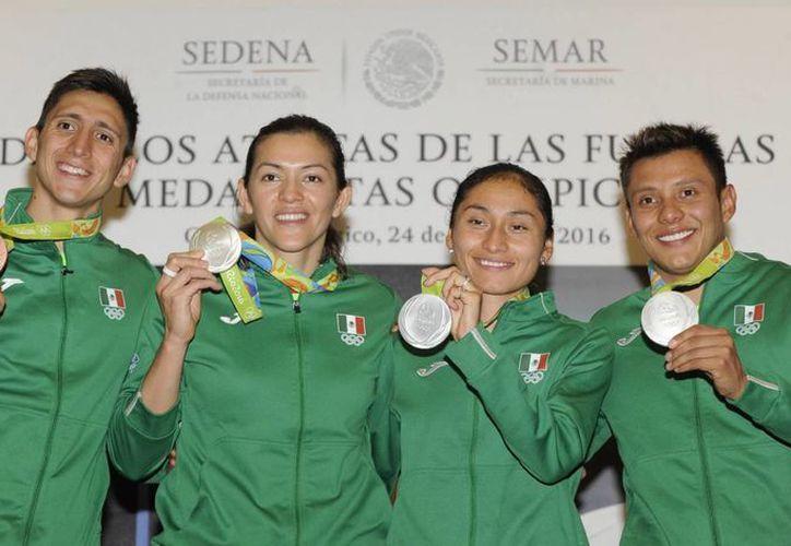 Cuatro de los cinco mexicanos que subieron al podio a Río pertenecen a las Fuerzas Armadas del país. (Archivo/EFE)