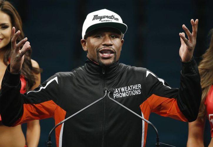 'De verdad, no creo que vaya a extrañar este deporte, declaró Floyd Mayweather después de ganar en el ring a Manny Pacquiao. (Foto: AP)