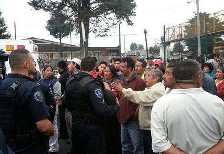 Los habitantes de Tres Marías exigen la aparición de un taxista que fue plagiado este viernes por la mañana. (Milenio)