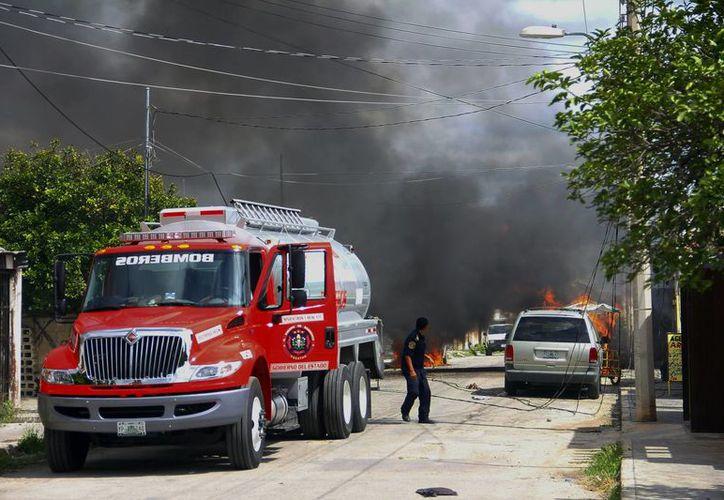 La pipa explotó en Polígono 108 por descuido de operadores, uno de ellos Sergio Alejandro Can González (a) <i>La Ranita</i> a quien le piden 118 mil pesos de fianza. (Milenio Novedades)</i></i>