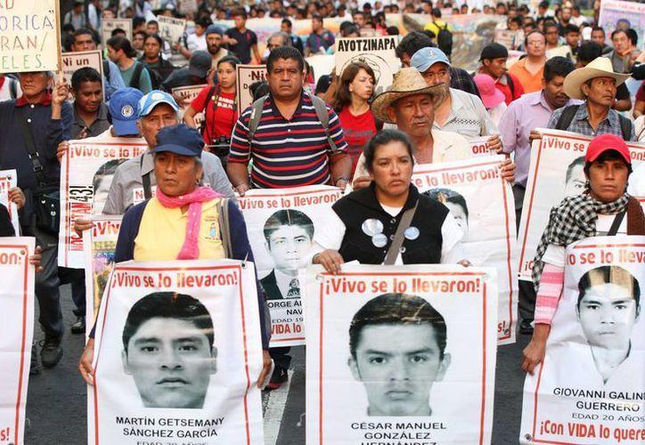 Organismos en Derechos Humanos aseguran que la PGR debe investigar la posible participación de policías de Huitzuco en la desaparición de los 43 normalistas. (Archivo/EFE)