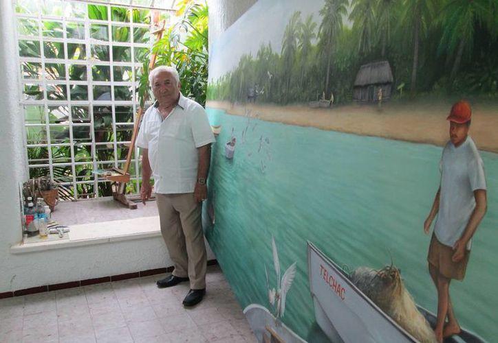 La naturaleza es la musa preferida del pintor Fernando Palma Burgos, con 60 años de trayectoria en el arte. Cree que sus cuadros pueden inspirar la defensa del medio ambiente. (Cecilia Ricárdez/SIPSE)