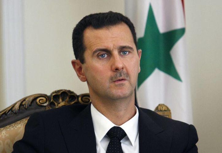 Assad mantiene una postura desafiante ante las potencias de Occidente. (Agencias)