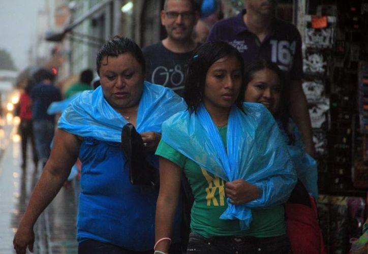 La afluencia de aire marítimo ocasionó lluvias ayer por la tarde en la mayor parte de la ciudad de Mérida y algunos puntos del estado. (Milenio Novedades)
