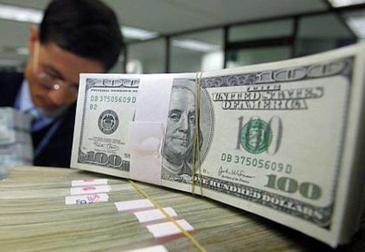El Banxico señala que el monto de remesas promedio fue de 285.79 dólares. (Archivo/Reuters)