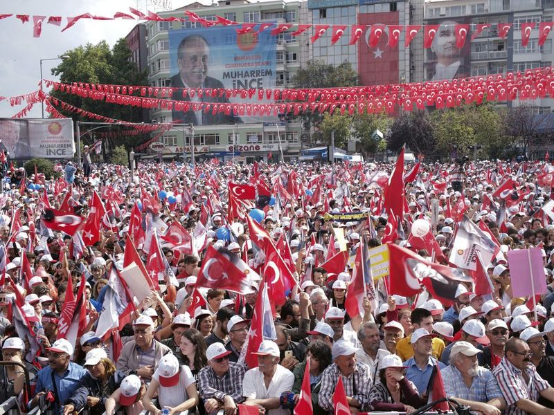 Supporters of Turkey's President and ruling Justice and Development Party leader Recep Tayyip Erdogan chant slogans.