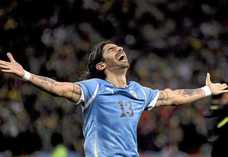 Sebastián Abreu, delantero uruguayo rompe récord por ponerse la camiseta número 26 en su historia del fútbol. (Contexto/Internet)