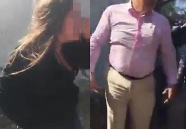 Madres de familia defendieron a la adolescente golpeada, mientras que un policía sujetó al golpeador para evitar que siguiera la agresión. (captura de pantalla)
