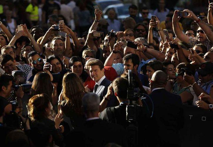 Tom dedicó varias horas a atender a todos los fans en Madrid, España. (Foto: AP)