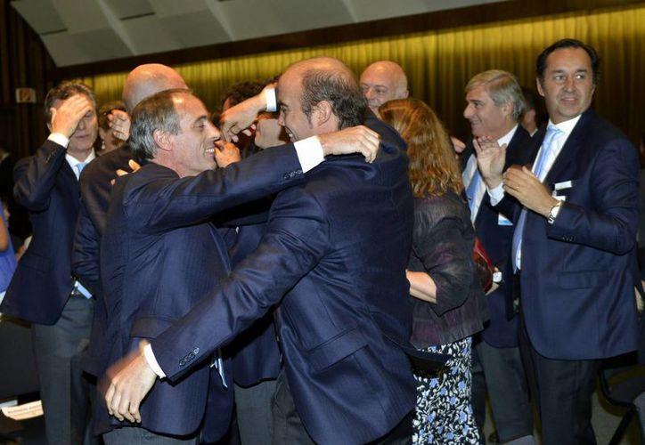 Miembros de la delegación argentina celebran la obtención de la sede. (Agencias)