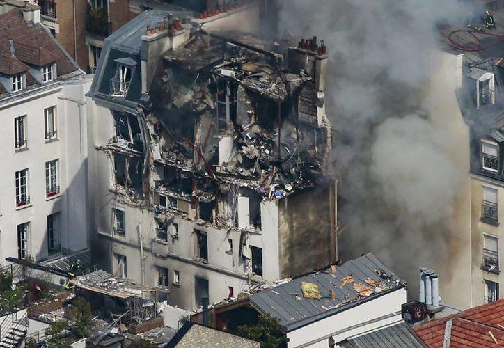La explosión destruyó casi por completo las tres últimas plantas del edificio. (EFE)