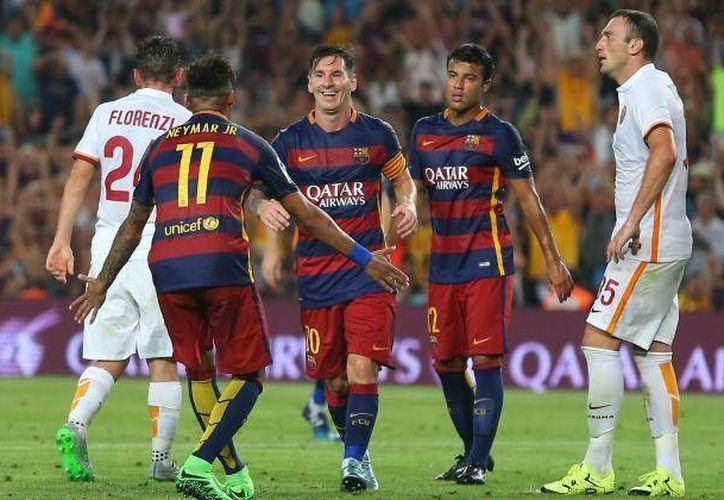 En su reencuentro, los astros blaugranas Neymar y Messi, dieron un buen partido ante la Roma, marcando goles al minuto 26 y 41, respectivamente, lo que contribuyó a que Barza ganara el trofeo Joan Gamper a la Roma. (AP)