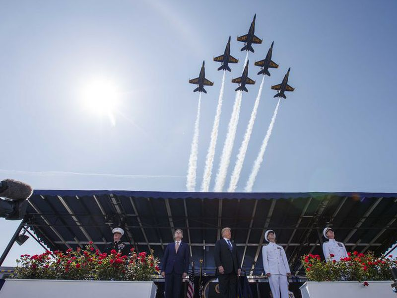 President Donald Trump looks on as the Blue Angels fly over the graduation ceremony at the U.S. Naval Academy, in Annapolis, Md. (AP)