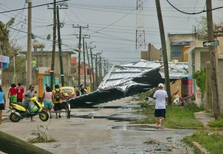 Si tienes imágenes del paso del huracán Wilma por Cozumel, puedes postularlas para que sean parte de una exposición fotográfica. (Gustavo Villegas/SIPSE)