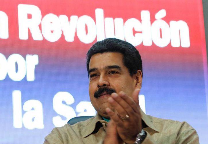 Este miércoles comenzaría en Venezuela el proceso de verificación de las firmas entregadas el lunes al Consejo Nacional Electoral para avanzar en el referéndum de la oposición contra el presidente Nicolás Maduro. (EFE)
