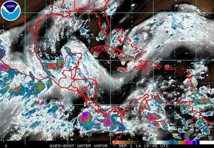 De acuerdo al Centro Nacional de Huracanes un sistema de baja presión ya se ha convertido en depresión tropical en el Golfo de México. (ssd.noaa.gov)