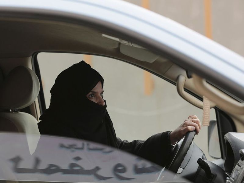 Aziza al-Yousef drives a car on a highway in Riyadh, Saudi Arabia, as part of a campaign to defy Saudi Arabia's ban on women driving.