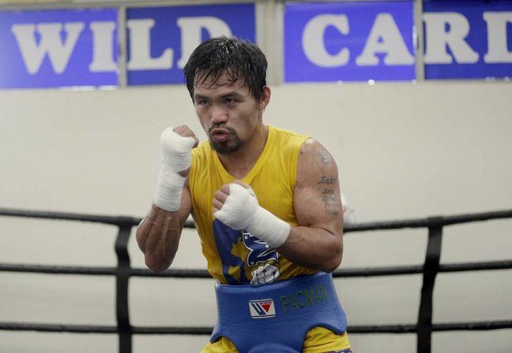 Manny Pacquiao dará fin a su carrera de 22 años este sábado, cuando se mida ante Timothy Bradley en Las Vegas. (AP)