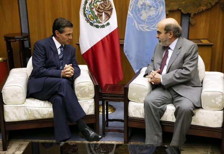 El presidente Enrique Peña Nieto y José Graziano Da Silva, director general de la Organización de las Naciones Unidas para la Agricultura y la Alimentación (FAO), sostuvieron una reunión privada en el marco de su participación en la Sesión de Clausura de la Conferencia Bianual del 39 periodo de sesiones de la FAO. (Notimex)