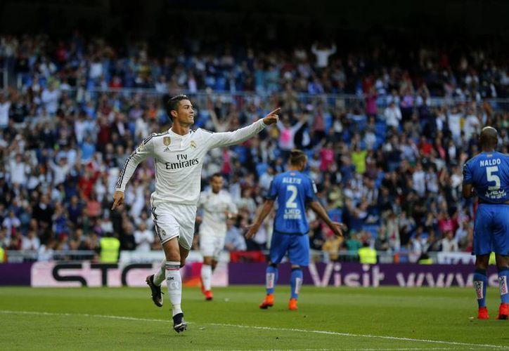 En una liga ya ganada por Barcelona, Cristiano Ronaldo anotó un triplete en el 7-3 sobre Getafe y ganó el Pichichi. (Fotos: AP)