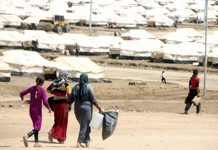 Las tensiones provocadas por el radical Estado Islámico han provocado la huida de miles de iraquíes hacia los campos de refugiados. (EFE)