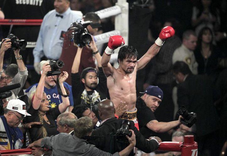 Manny Pacquiao se tomará el tiempo para pensar si la pelea de este sábado fue realmente la última de su carrera o si más adelante regresará al ring. (AP)
