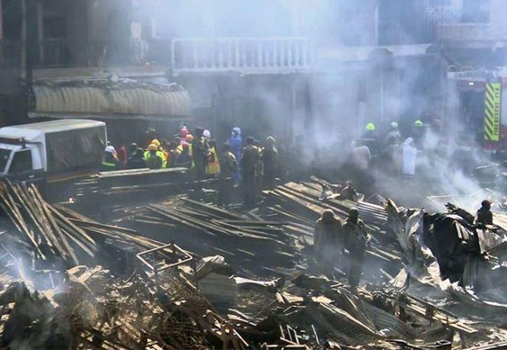 Murieron quemadas y otras inhalaron vapores altamente tóxicos al intentar salvar sus propiedades. (Foto: AP)