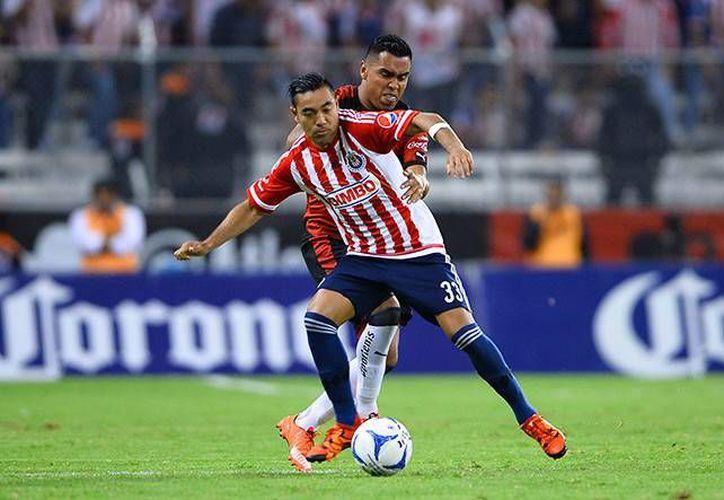 Al minuto 77 Marco Fabián marcó un soberbio gol de tiro libre con el que el Guadalajara se llevó el Clásico tapatío, el cual había sido pospuesto por el impacto del huracán Patricia en la Jalisco. (Mexsport)