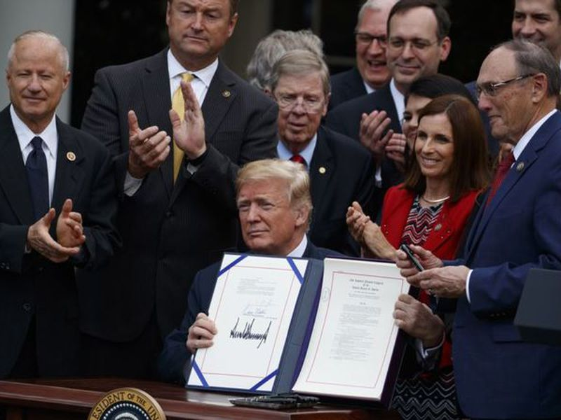 "President Donald Trump speaks during a bill signing ceremony for the ""VA Mission Act"" in the Rose Garden of the White House, in Washington."
