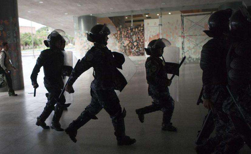 Honduras reforzará los límites que comparte con otros tres países para evitar el ingreso de delincuentes. (EFE)