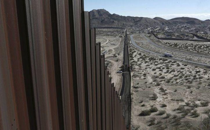 El presidente de Estados Unidos, Donald Trump, solo ha reunido una milésima parte de lo que se requiere para construir el muro fronterizo con México. (AP)