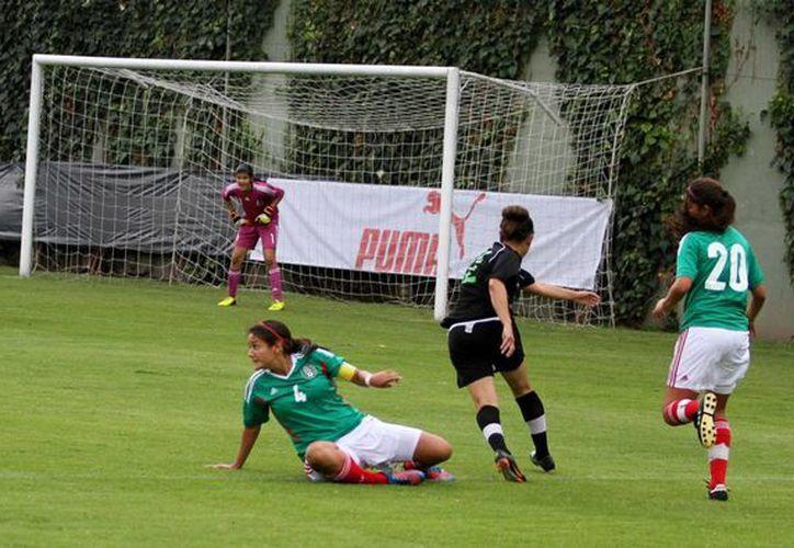 Las mexicanas ganaron el pase al Mundial Fenenil Sub-20 Canadá 2014 y el boleto para disputar la final del Premundial de la Concacaf Islas Caimán 2014. (Notimex)